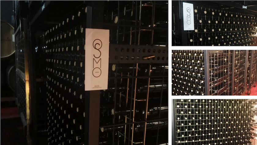 Bottles of OSMO Crianza DOCA Rioja ready in these wine cages.